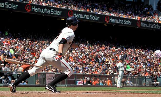 San Francisco Giants Brandon Belt watches his base hit during theirMLB baseball game against the Arizona Diamondbacks Monday May 28, 2012 at AT&T Park in San Francisco California. Giants won 4-2. Photo: Lance Iversen, The Chronicle