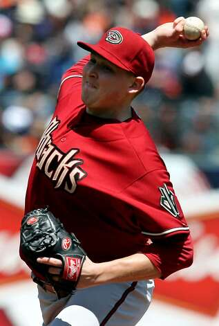 Arizona Diamondbacks starting pitcher Trevor Cahill trows to the San Francisco Giants in the second inning  of their MLB baseball game  Monday May 28, 2012 at AT&T Park in San Francisco California. Photo: Lance Iversen, The Chronicle