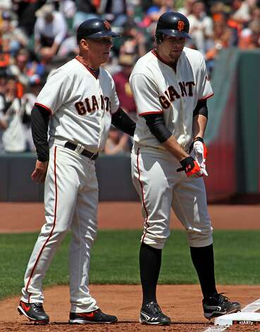 San Francisco Giants 3rd base coach Tim Flannery talks to Brandon Belt after Belt hit a triple against the Arizona Diamondbacks during their MLB baseball game  Monday May 28, 2012 at AT&T Park in San Francisco California. Giants won 4-2 Photo: Lance Iversen, The Chronicle