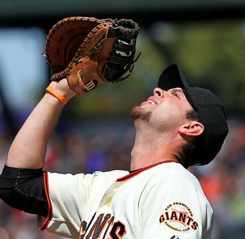 San Francisco first baseman Brandon Belt catches a fly ball by Arizona Diamondbacks Justin Upton in the 6th inning of their MLB baseball game  Monday May 28, 2012 at AT&T Park in San Francisco California. Giants won 4-2. Photo: Lance Iversen, The Chronicle