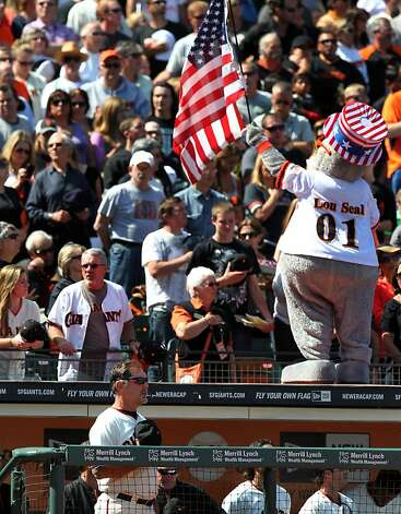 San Francisco Giants manager Bruce Bochy stands with the fans to pay tribute to the military, past and present on Memorial Day during the 7th inning stretch during their game with the Arizona Diamondbacks Monday May 28, 2012 at AT&T Park in San Francisco California. Photo: Lance Iversen, The Chronicle