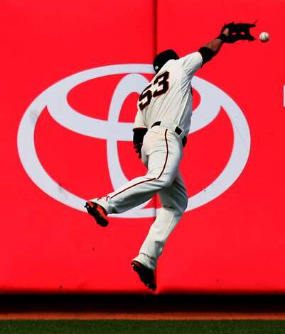 San Francisco Giants Melky Cabrera leaps for strike to center field by Arizona Diamondbacks Paul Goldschmidt who got a double on the play in the sixth inning of their MLB baseball game  Monday May 28, 2012 at AT&T Park in San Francisco California. Photo: Lance Iversen, The Chronicle