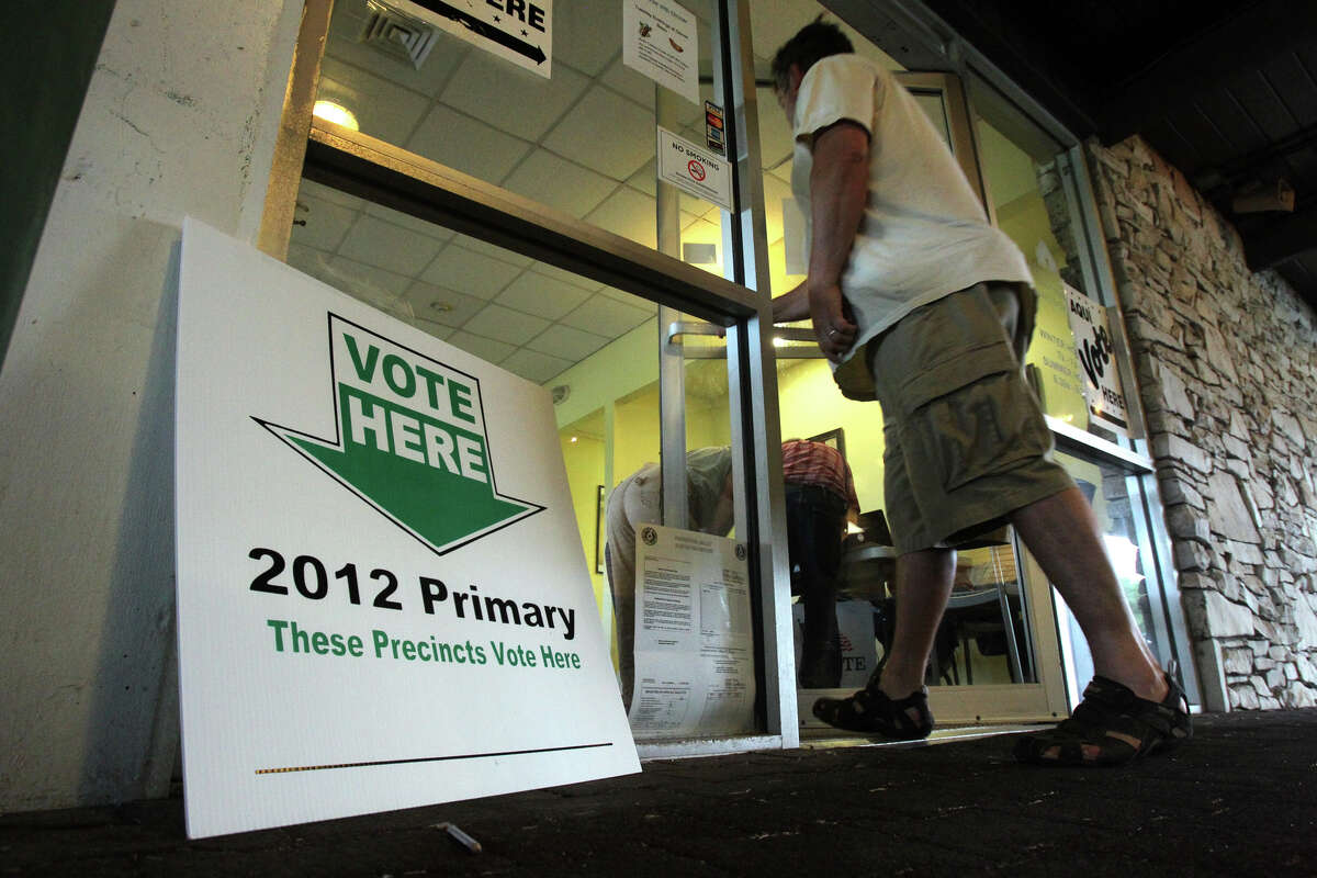 A voter enters the polling site Tuesday, May 29, 2012, at the Olmos Basin Golf Course a few minutes after 7 a.m.