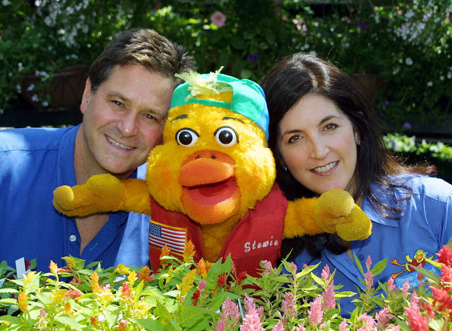Stew Leonard Jr. and his wife, Kim, are shown with Stewie the Duck, the water safety character they created as a result of the drowning death of their 21-month-old son, Stewie III, in 1989. Photo: Contributed Photo