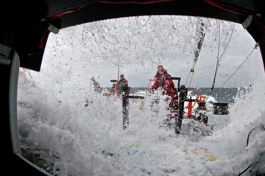 In this photograph provided by the Volvo Ocean Race, Waves crash over the deck of Team Sanya during leg 7 of the Volvo Ocean Race 2011-12, from Miami, USA to Lisbon, Portugal, on Tuesday, May. 29, 2012 (Andres Soriano/Team Sanya/Volvo Ocean Race photo via AP Images) EDITORIAL USE ONLY Photo: ANDRES SORIANO, Associated Press / Volvo Ocean Race
