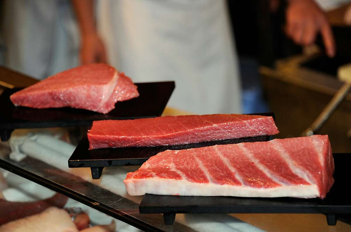Sushi restaurant chain Sushi-Zanmai displays blocks of fat meat tuna cut out from a 269kg bluefin tuna to serve customers at the main restaurant of Sushi-Zanmai near Tokyo's Tsukiji fish market in this January 5, 2012 file photo. Bluefin tuna caught off the US coast have been found to contain radioactive material from Japan's quake-struck Fukushima nuclear plant, according to a new study.Researchers found