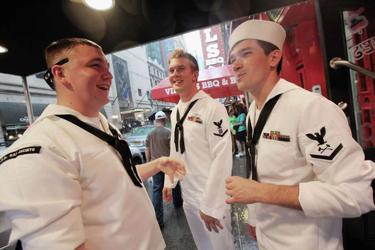 NEW YORK, NY - MAY 26: U.S. Navy sailors gather outside a bar during Fleet Week festivities on May 26, 2012 in New York City. Fleet week, which has been held in New York City since 1984, celebrates the U.S. Navy and Marines Corps with a week of ship visitations and military demonstrations. Fleet Week concludes on Memorial Day with a military flyover to honor those killed while serving in the military.