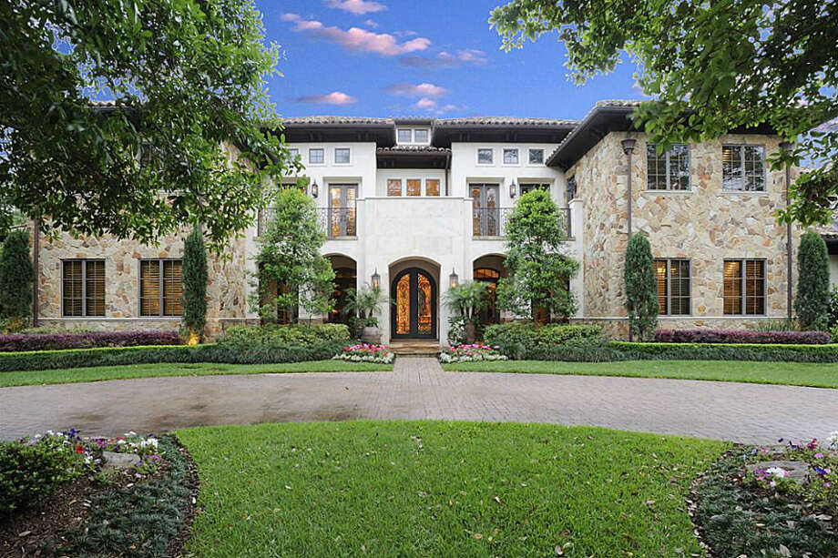 A look at the front exterior of the two-story home, which features eight bedrooms, eight full bathrooms, and two half-baths. Photo: Realtor.com