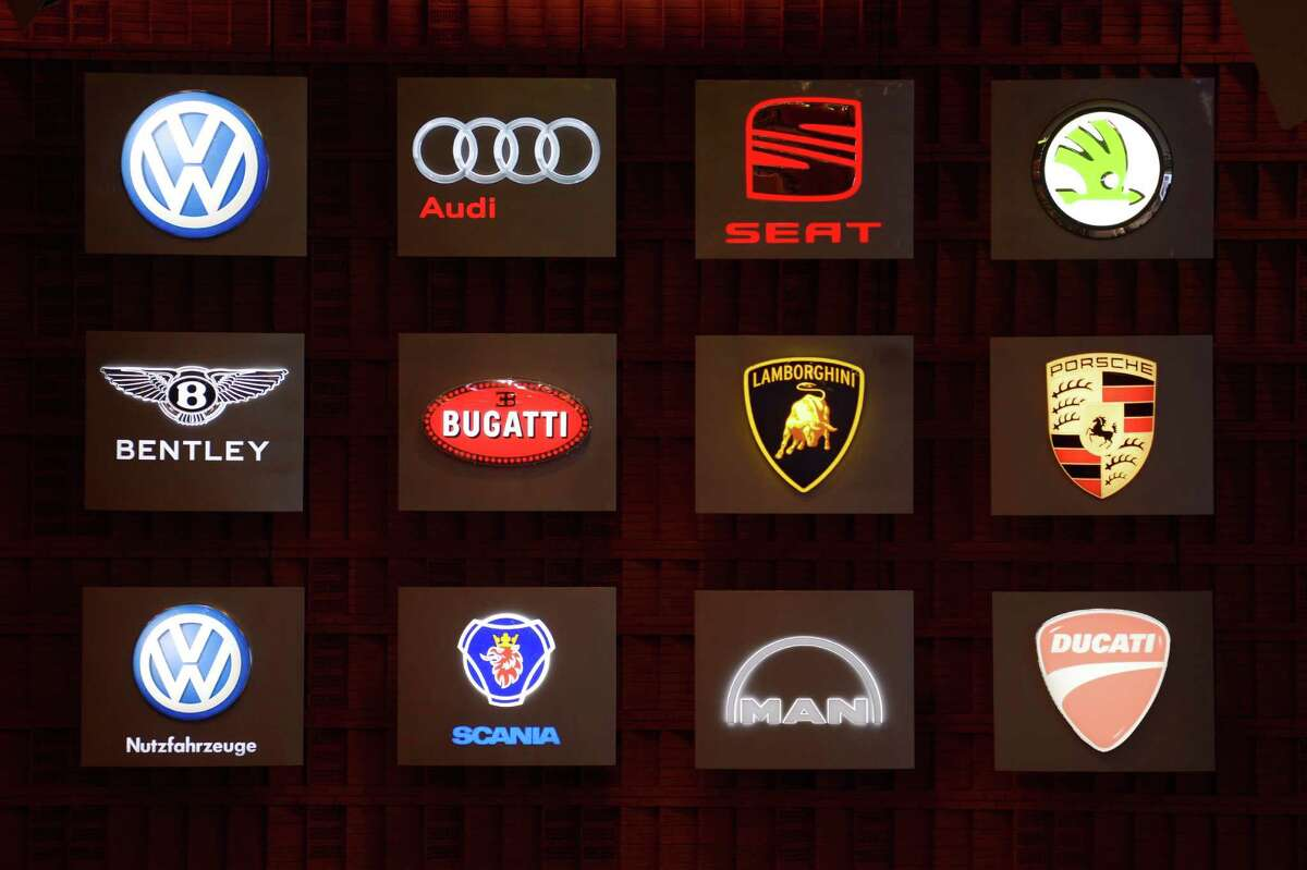 A board showing the logos of car brands Volkswagen, Audi, Seat, Skoda, Bentley, Bugatti, Lamgorghini, Porsche, Scania, Man, Ducati belonging to the German auto giant Volkswagen is dislayed during the company's annual general meeting on April 19, 2012 in Hamburg, northern Germany.  AFP PHOTO / OLIVER HARDT