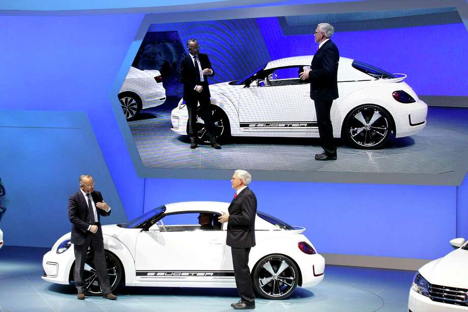 DETROIT, MI - JANUARY 9: Walter de Silva (L), Head of Group Design Volkswagen Group, and Dr. Ulrich Hackenberg, Member of the Board Volkswagen Brand, reveal the new E Bugster during a media, and preview at the 2012 North American International Auto Show January 9, 2012 in Detroit, Michigan. The show is open to the general public January 14-22. Photo: Bill Pugliano, Getty / 2012 Getty Images