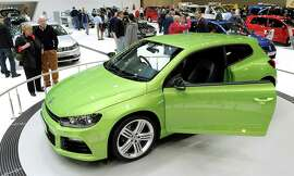 A Volkswagen Scirocco R coupe is displayed at the Australian International Motor Show in Melbourne on July 5, 2011.  AFP PHOTO/William WEST