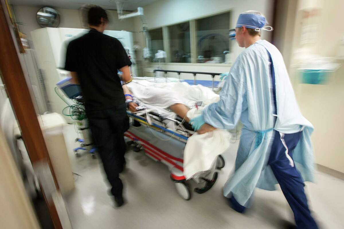 A patient is moved into room for a CT scan in the trauma center at Memorial Hermann Hospital on Saturday, May 26, 2012, in Houston.
