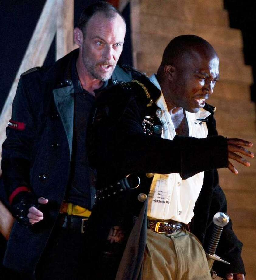 "Dylan Collins (left) as Iago and James ""Apollo"" Bradley as Othello in Magik Theatre's production for Shakespeare in the Park 2012. Photo: Courtesy David Frank"