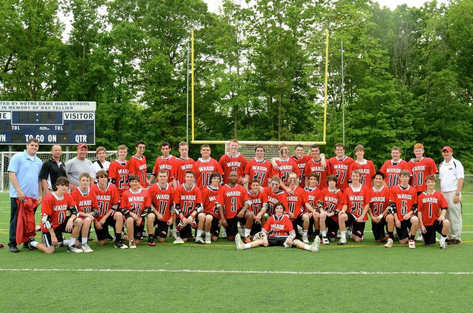 The Fairfield Warde boys lacrosse team celebrates its first state tournament win ever, an 8-4 victory over ND-West Haven on Friday in West Haven. Photo: Contributed Photo