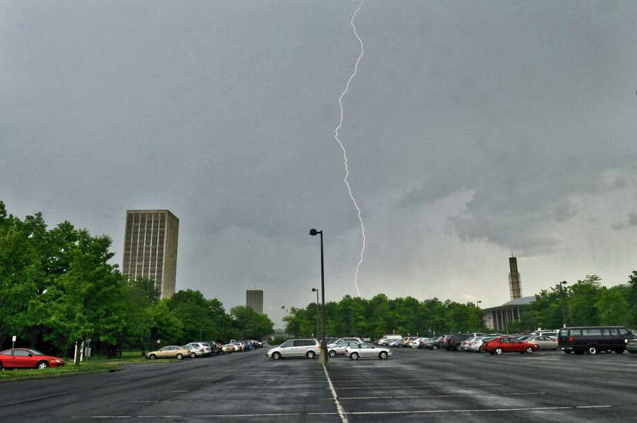 Lightning strikes near the UAlbany campus on Tuesday afternoon May 29, 2012 in Albany, NY.  A tornado watch was issued for Tuesday afternoon.  (Philip Kamrass / Times Union ) Photo: Philip Kamrass / 00017861A