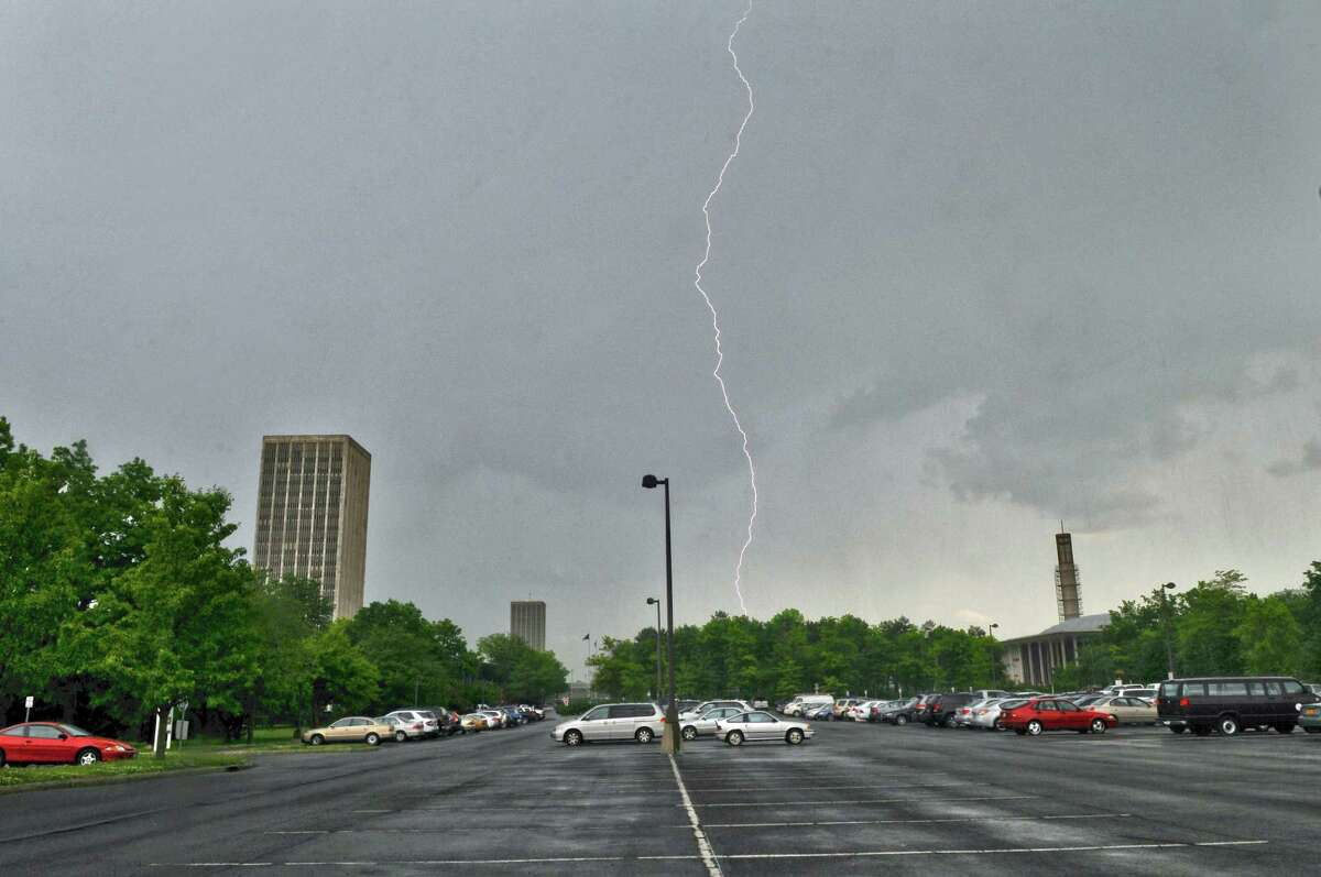 The region faces the possibility that strong thunderstorms could hit between noon and 4 p.m. Friday. Though the storms will move out in the afternoon, the National Weather Service predicts 40-50 mph winds could linger until midnight.In this photograph, lightning strikes near the UAlbany campus on Tuesday afternoon May 29, 2012 in Albany, NY. A tornado watch was issued for Tuesday afternoon. (Philip Kamrass / Times Union )
