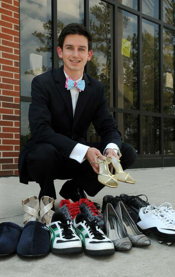 TWHS senior Garrett Neville, 18, shows off some of his shoes. Freelance photo by Jerry Baker Photo: Jerry Baker