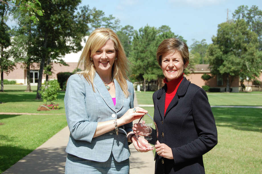 Pictured are LMC Board Chairman Danielle Scheiner of Entergy Texas Inc. and Ambler of The Woodlands Christian Academy.