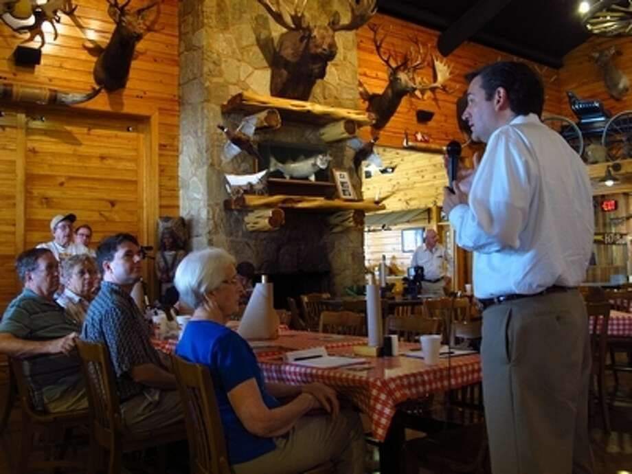 Ted Cruz addresses a crowd of about 20 supporters at a restaurant in Temple on Saturday, May 26. Cruz vowed that, given a runoff against Lt. Gov. David Dewhurst, he would win the Republican nomination. (Associated Press)