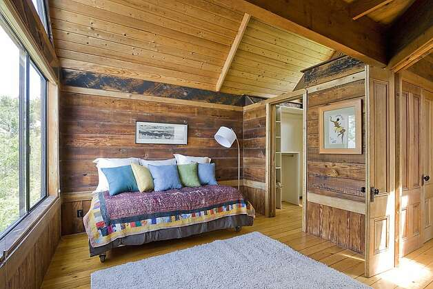 The upper level includes the master bedroom and a second bedroom (pictured), connected by a catwalk. Photo: Rob Jordan