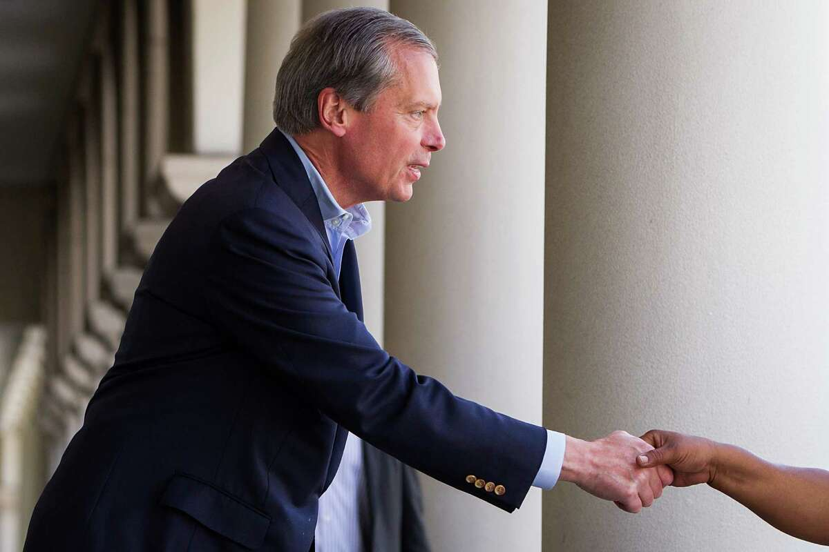 U.S. Senate candidate David Dewhurst shakes a hand as he arrives at Kenny & Ziggy's New York Delicatessen Restaurant for a campaign appearance on Tuesday, May 29, 2012, in Houston.