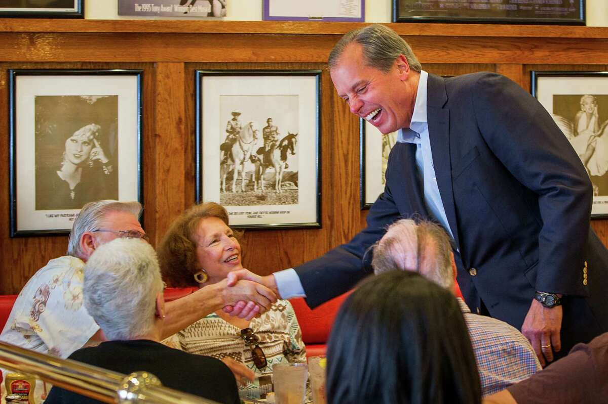 U.S. Senate candidate David Dewhurst visits with diners at Kenny & Ziggy's New York Delicatessen Restaurant on Tuesday, May 29, 2012, in Houston.