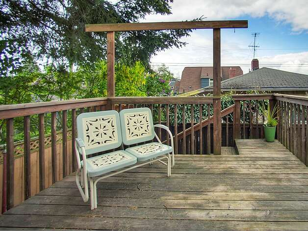 Deck of 3003 44th Ave. S.W. The 1,580-square-foot house has three bedrooms, 1.75 bathrooms, built-in shelves in the living room, a 'shabby chic' kitchen with open shelves and a tile floor, a lower-level family room, a backyard and raised garden beds on the 3,234-square-foot corner lot. It's listed for $349,000, although a sale is pending. Photo: Courtesy Barb Hunsinger/Windermere Real Estate