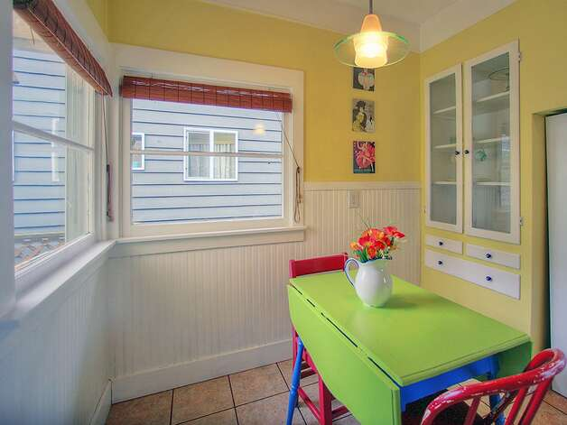 Kitchen eating area of 3003 44th Ave. S.W. The 1,580-square-foot house has three bedrooms, 1.75 bathrooms, built-in shelves in the living room, a lower-level family room, a backyard deck and patio and raised garden beds on the 3,234-square-foot corner lot. It's listed for $349,000, although a sale is pending. Photo: Courtesy Barb Hunsinger/Windermere Real Estate