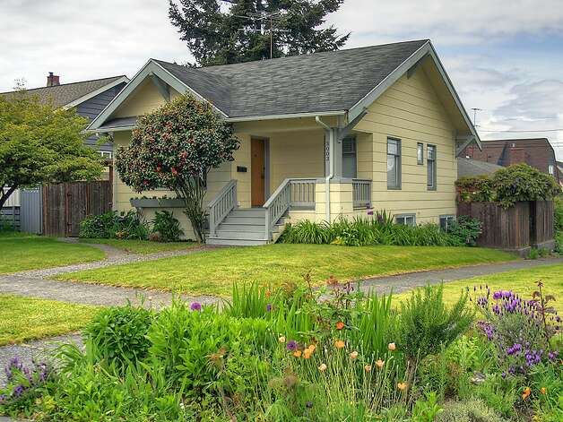 Last comes our lowest-priced home, 3003 44th Ave. S.W., which is listed for $349,000, although a sale is pending. The 1,580-square-foot house has three bedrooms, 1.75 bathrooms, built-in shelves in the living room, a 'shabby chic' kitchen with open shelves and a tile floor, a lower-level family room, a backyard deck and patio and raised garden beds on the 3,234-square-foot corner lot. Photo: Courtesy Barb Hunsinger/Windermere Real Estate