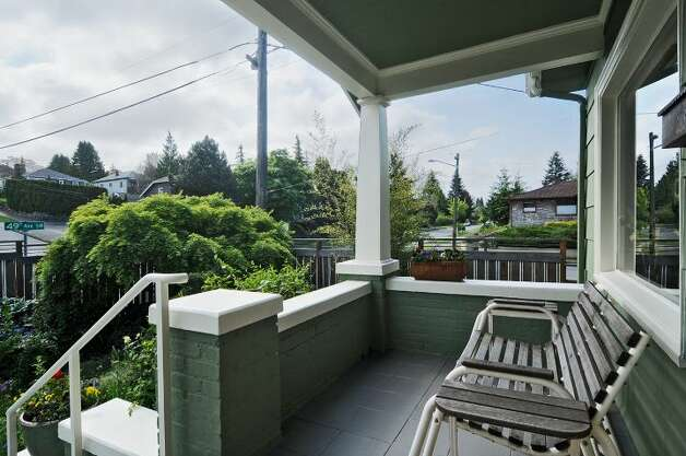 Front porch of 2659 49th Ave. Court S.W. The 2,080-square-foot home, built in 1911, has two bedrooms, 1.75 bathrooms, built-in cabinets, crown moldings, a basement rec room, a fenced front garden, and a back patio on a 4,830-square-foot lot. It's listed for $399,900. Photo: Courtesy John Pettas/Windermere Real Estate
