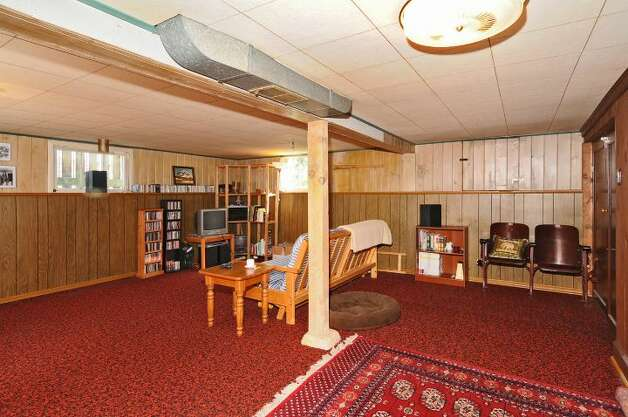 Basement rec room of 2659 49th Ave. Court S.W. The 2,080-square-foot home, built in 1911, has two bedrooms, 1.75 bathrooms, built-in cabinets, crown moldings, a fenced front garden, and a back patio on a 4,830-square-foot lot. It's listed for $399,900. Photo: Courtesy John Pettas/Windermere Real Estate