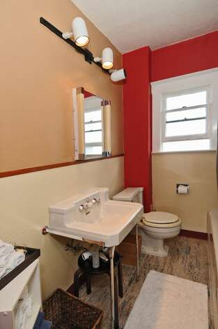 Bathroom of 2659 49th Ave. Court S.W. The 2,080-square-foot home, built in 1911, has two bedrooms, 1.75 bathrooms, built-in cabinets, crown moldings, a basement rec room, a fenced front garden, and a back patio on a 4,830-square-foot lot. It's listed for $399,900. Photo: Courtesy John Pettas/Windermere Real Estate