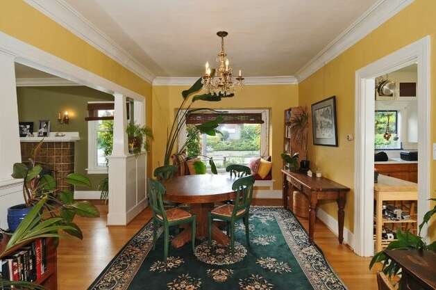 Dining room of 2659 49th Ave. Court S.W. The 2,080-square-foot home, built in 1911, has two bedrooms, 1.75 bathrooms, built-in cabinets, crown moldings, a basement rec room, a fenced front garden, and a back patio on a 4,830-square-foot lot. It's listed for $399,900. Photo: Courtesy John Pettas/Windermere Real Estate