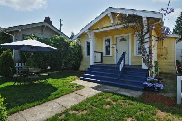 Next comes 3805 S.W. Admiral Way. The 710-square-foot house, built in 1919, has two bedrooms, one bathroom, French doors, a gas fireplace, parking for three cars and a storage shed on a 3,200-square-foot lot. It's listed for $350,000. Photo: Courtesy Terry Miller/Coldwell Banker Bain