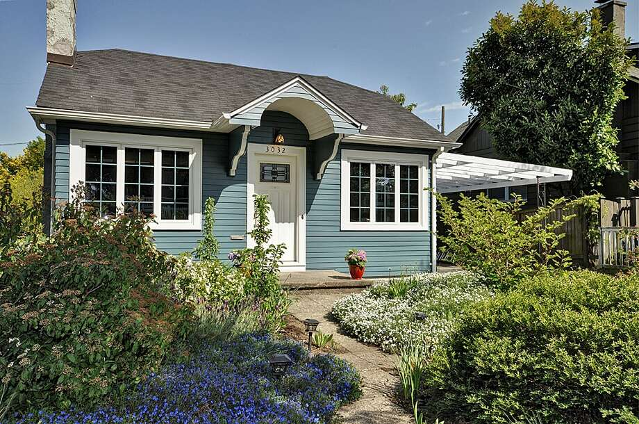Admiral is at the north end of West Seattle, with great views, nice houses and convenient access to the Junction and bridge. Here are four homes there for $350,000 to $400,000, starting with 3032 Walnut Ave. S.W. The 1,340-square-foot house, built in 1924, has two bedrooms, one bathroom, coved ceilings, an office with built-in desk and Murphy bed, lower-level rec room, attic room, rear deck and a hot tub on a 3,440-square-foot lot. It's listed for $385,000. Photo: Courtesy Gini Johnson/Prudential Northwest Realty