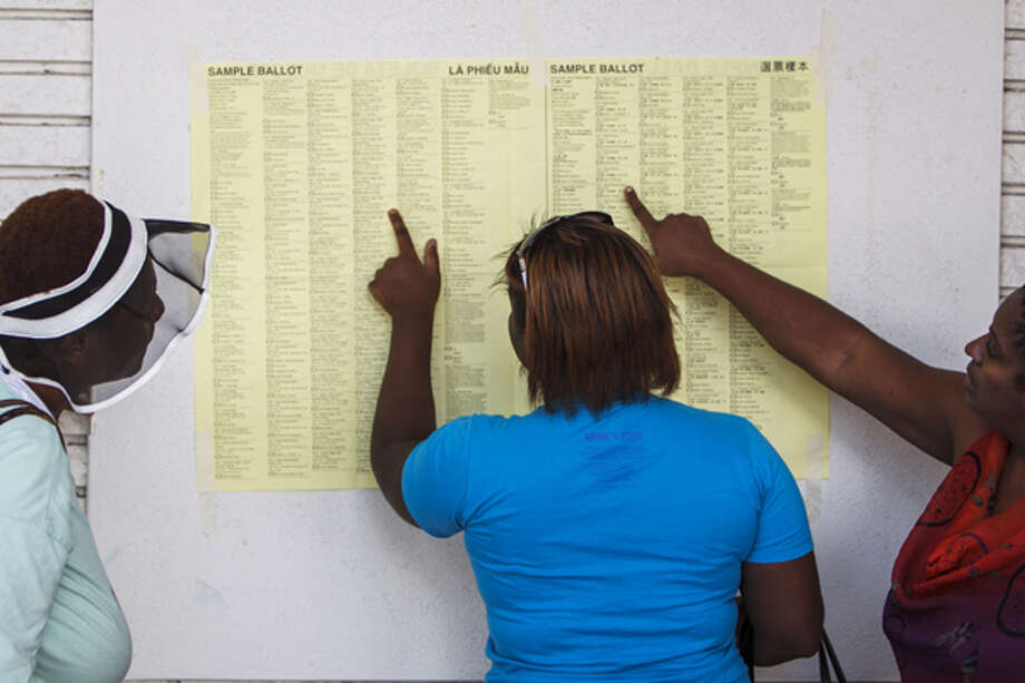Dorthey Rogers, left to right, Amanda Roper and Tabatha Roper Mitchell look at a sample ballot after casting their vote at the Palm Center, 5300 Griggs Road, for the 2012 Texas Primary, Tuesday, May 29, 2012, in Houston.  (Michael Paulsen / Houston Chronicle)