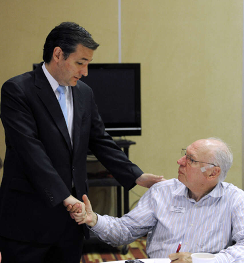 Ted Cruz is shown with his father, Rafael Cruz, in 2012, in Houston.