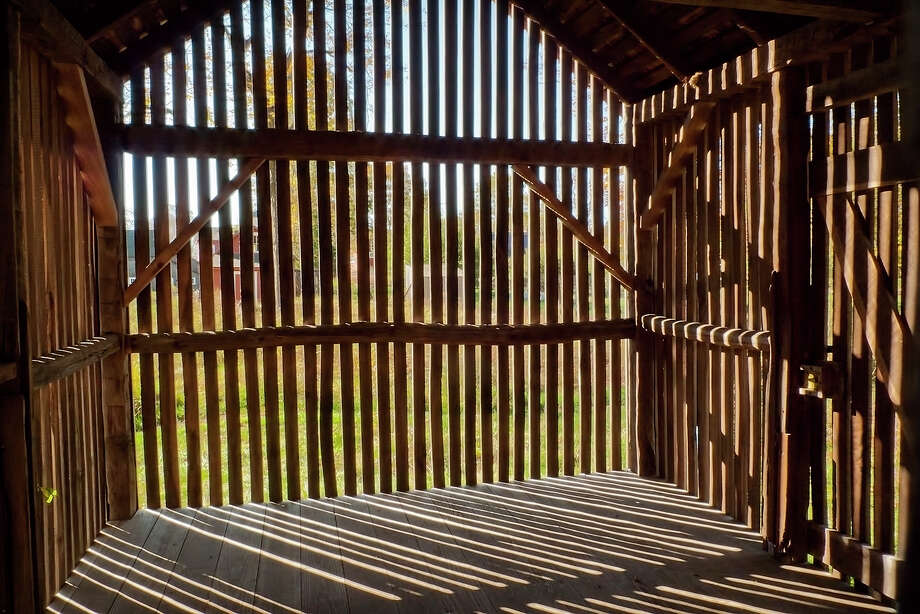 """Corn Crib Light"" by Ron Landis is on view in ""Impressions of Weir Farm,"" the Westport photographer's upcoming exhibition at the River Road Gallery, which documents two years at Connecticut's only national park. Photo: Contributed Photo / Connecticut Post Contributed"
