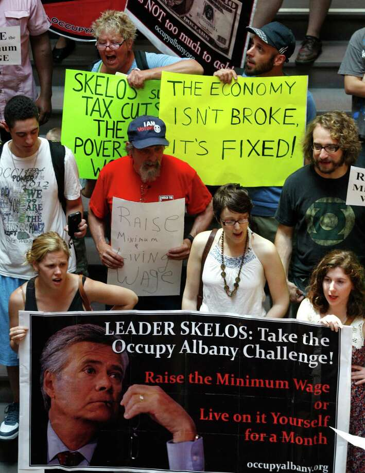 Occupy Albany protesters rally for a raise in the state's minimum wage on the Great Western Staricase at the Capitol in Albany N.Y., on Tuesday, May 29, 2012. About 40 protesters wound throughout the building Tuesday, chanting and refusing to accept that the measure is politically dead. (AP Photo/Mike Groll) Photo: Mike Groll