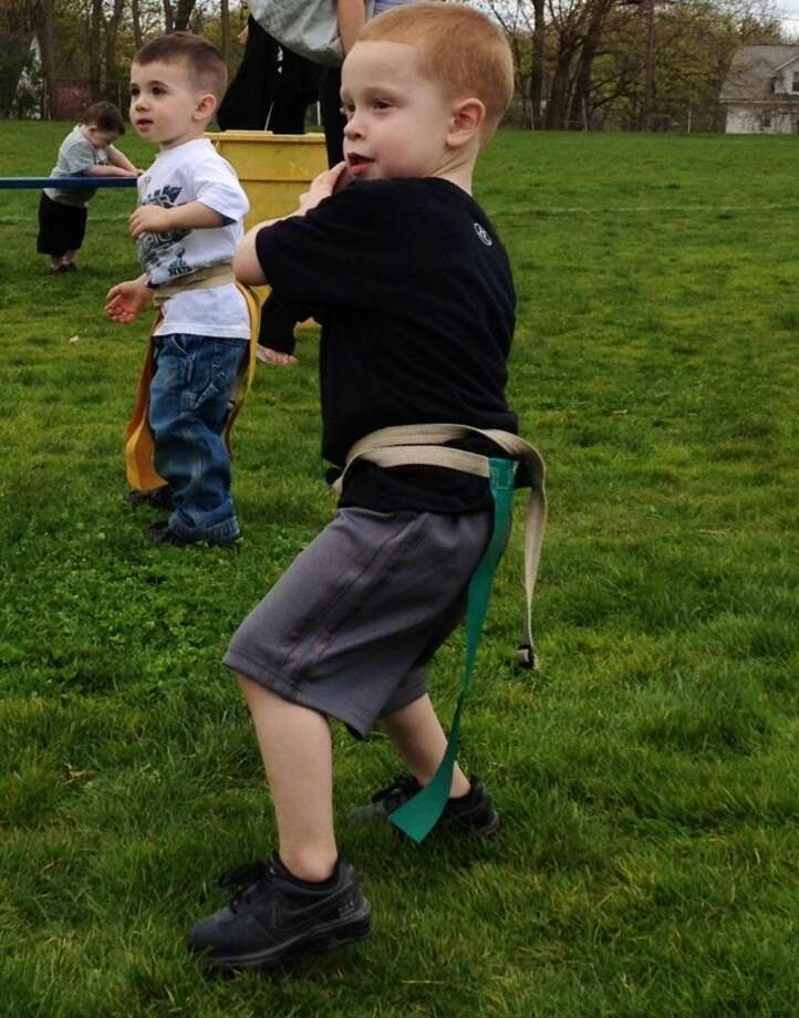 Zackary wishes he was old enough to play flag football like Daddy. (Meagan Palmer)