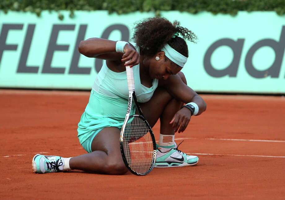 Serena Williams lost in the first round in a Grand Slam for the first time after a setback to Virginie Razzano at the French Open on Tuesday. Photo: AP