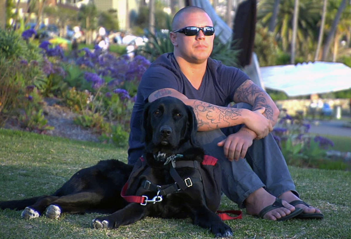 In this February 2012 photo released by ShelterMe.com showing a photo of Andrew J. Trotto with his dog Teka during the documentary