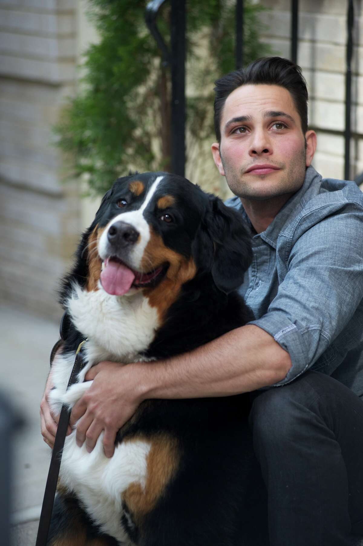 This undated image released by CBS shows dog guru Justin Silver, host of the new show