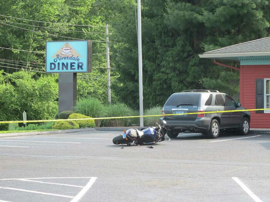 A man was seriously injured in a motorcycle crash on River Road in Shelton, Conn. in front of the Riverdale Diner around 4:30 p.m. on Tuesday May 29, 2012. Photo: Tom Cleary