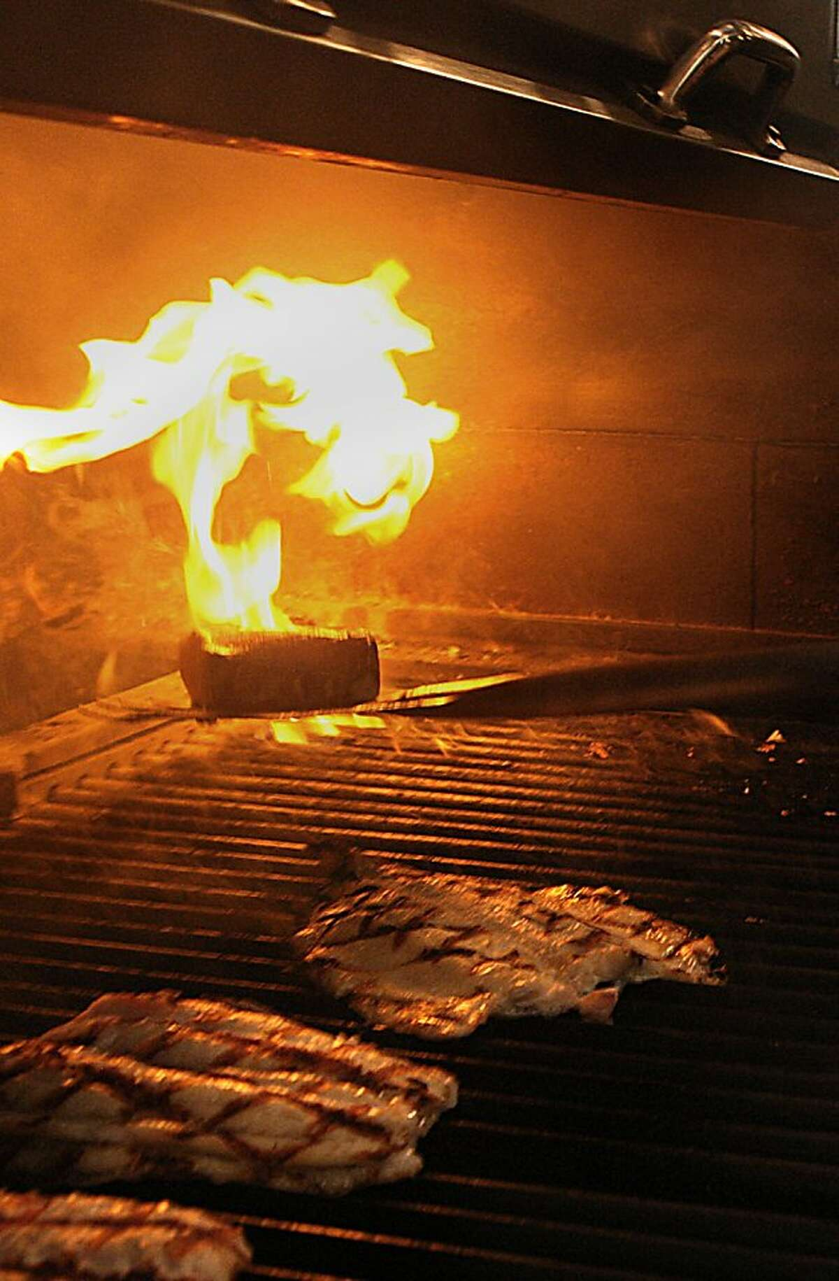 Fish being prepared at Tadich Grill in San Francisco, Calif., on Thursday, December 15, 2011.