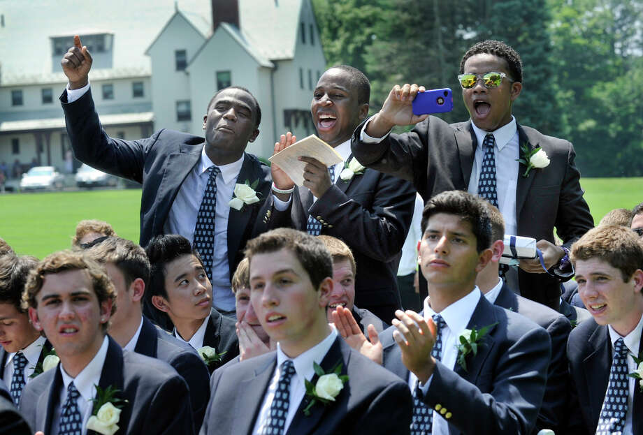 Cheering their fellow graduates during the Canterbury School graduation are from left, Troy Williams, Raheem Logan, and Sam Maximin, Tuesday, May 29, 2012 in New Milford, Ct. Photo: Carol Kaliff / The News-Times