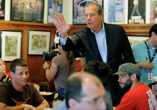 US Senate Republican primary candidate, Texas Lt. Gov. David Dewhurst, visits with restaurant, on election day Tuesday, May 29, 2012, in Houston. Photo: Pat Sullivan, Associated Press