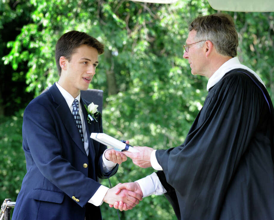 Logan Pettinato, of Sherman, accepts an award from Headmaster Thomas J. Sheehy III at the Canterbury School's graduation ceremony Tuesday, May 29, 2012 ,in New Milford. Photo: Carol Kaliff
