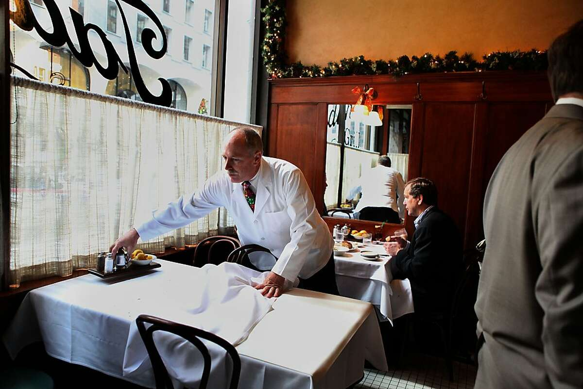 General manager Rick Powers fixing a table at Tadich Grill in San Francisco, Calif., on Thursday, December 15, 2011.