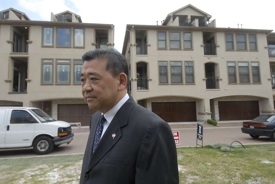 Steven Teoh (RE/MAX agent) walks the new townhome property at the corner of Yorkstone and Rosastone at CITYCENTRE next to Town and Country Mall Thursday 5/03/12. Photo by Tony Bullard. Photo: Tony Bullard / © Tony Bullard & the Houston Chronicle